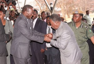 PRESIDENT Sata greets Archbishop Telesphore Mpundu on arrival for Medardo Cardinal Mazombwe's requiem mass at the Cathedral of the Child Jesus on Monday. – Picture by CHANDA MWENYA.