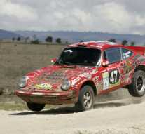 Bjorn Waldegard jumps his Porsche 911 on the 2009 Safari Rally
