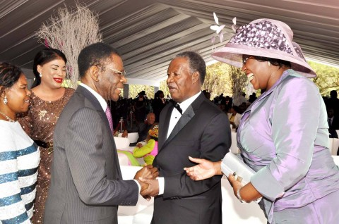 Equatorial Guinea President Teodoro Obiang Nguema Mbasogo (l) greeets President Sata as First Lady Dr Christine Kaseba looks on during the wedding ceremony of Bona Mugabe (second from right),