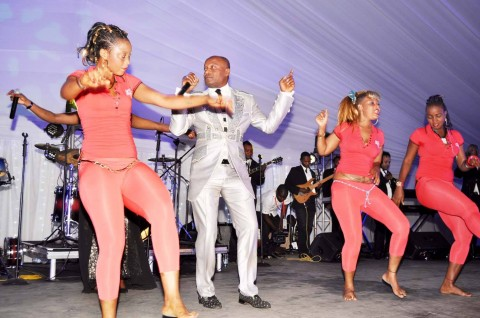 Koffi Olomide and dancing queens during the wedding ceremony of Bona Mugabe, Daughter to Robert Mugabe , President of the Republic of Zimbabwe and Simba