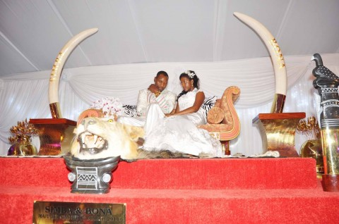 Simba Chikore with Bona Mugabe, Daughter to Robert Mugabe , President of the Republic of Zimbabwe during their wedding Ceremony in Harare, Zimbabwe on March 1,2014 -Picture by THOMAS NSAMA