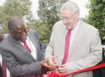 VICE President Guy Scott (right) is assisted to cut the ribbon by Minister of Mines, Energy and Water Development, Christopher Yaluma during the official opening of the Copperbelt Mining Trade Expo