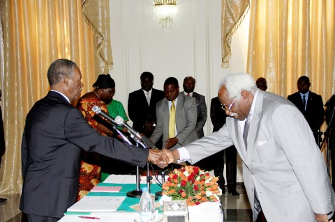 Ambassador Mumba Kapumpa who has been sent to South Korea, shakes hands with President Sata
