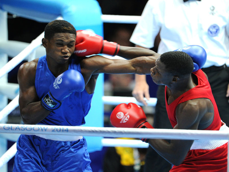 Jamaica's Michael Gardener (left) is hit with a right to the head by Zambia's Benny Muziyo in a men's 75Kg preliminary fight at the Commonwealth Games. Gardener was defeated by Muziyo at the Scottish Exhibition and Conference Centre. - Ricardo Makyn/Staff Photographer