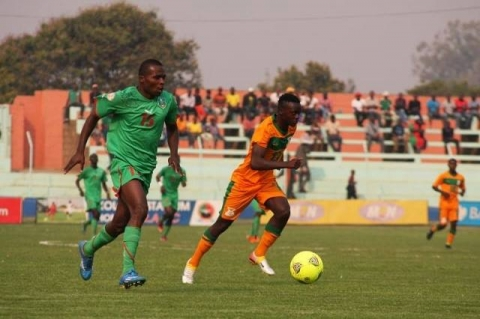 Zambia U20 defender Kayawe Kapota takes the ball away from Malawi's Shumacher Kuwali #fazfootball