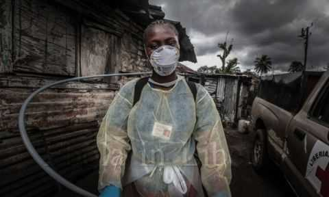 A Red Cross burial team Photograph- Marcus DiPaola:NurPhoto:Rex - Ebola crisis in Liberia