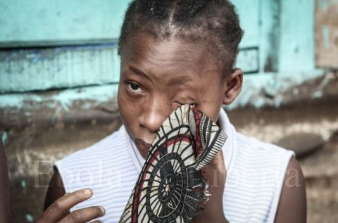 A young girl cries as her mother is taken away - Ebola crisis in Liberia