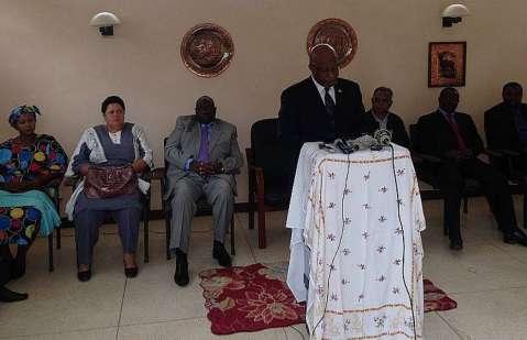 Dr Nevers Mumba speaking with NEC Members seated (left to right): Elizabeth Chitika, Winnie Zaloumis, Prof. Geoffrey Lungwangwa, Suresh Desai, Mwansa Mbulakulima and Howard Kunda.