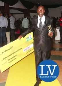 Best Assistant Referee Lusaka based Bruno Tembo, DSTV Communication Manager Marlon Kananda   - Image Credit - Jean Mandela