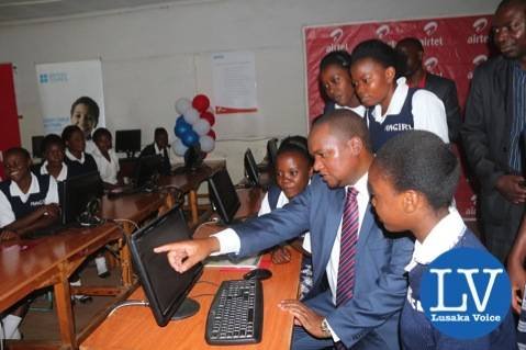 Miles demonstrating the use of Computer to some Matero Girls pupils     - Photo Credit Jean Mandela - Lusakavoice.com