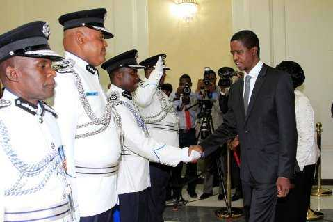 President Edgar Lungu greets Eastern Province Commissioner of Police Hudson Namachila during the Swearing in ceremony. Looking on are Mr Auxensio Daka and Stanslous Agrippa Mukuka Chewe