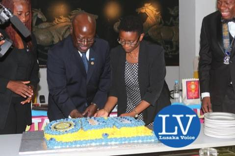 Rotary International District 9210 Governor Kenneth Chibesakunda with ECZ Director (Guest of Honour) Isaac Priscilla cutting the cake.   - Photo Credit Jean Mandela - Lusakavoice.com
