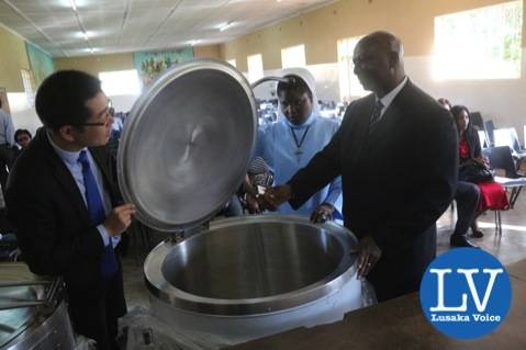 from left to right-  ZTE Managing Director Billy Yi, Former ZESCO MD Cyprian Chitundu and Kasisi Girls Head Teacher Sr Prisca Phiri unveiling one of the electric pots!       - Photo Credit Jean Mandela - Lusakavoice.com