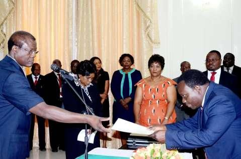 Acting President Ngosa Simbyakula receives an affidavit of Oath from Muchinga Province Permanent Secretary Bright Nundwe (r) during the Swearing-In-Ceremony at State House on March 13,2015 -Picture by THOMAS NSAMA