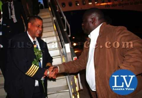 Minister of Transport and Communication Christopher Yaluma greeting the Rwandair Director of Flight Operations Santos Pio after landing   - Photo Credit Jean Mandela - Lusakavoice.com