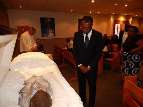 Zambia's High Commissioner to South Africa, His Excellency Mr. Muyeba Chikonde pays his last respects