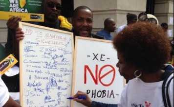 Apr 25 UK #NoToXenophobia march in London - campaigners handing petition to South African High Commission @SABCNewsOnline - Credit - Dan Whitehead @danwnews