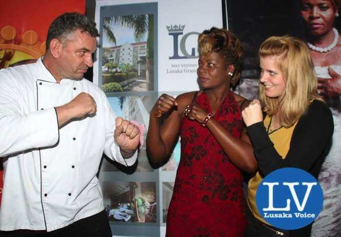 Lusaka Grand Hotel Executive Chef Eric Buitendjik , Boxer Esther Phiri, Lusaka Grand Hotel  Media & Public Relations Manager Janina Baalmann ,