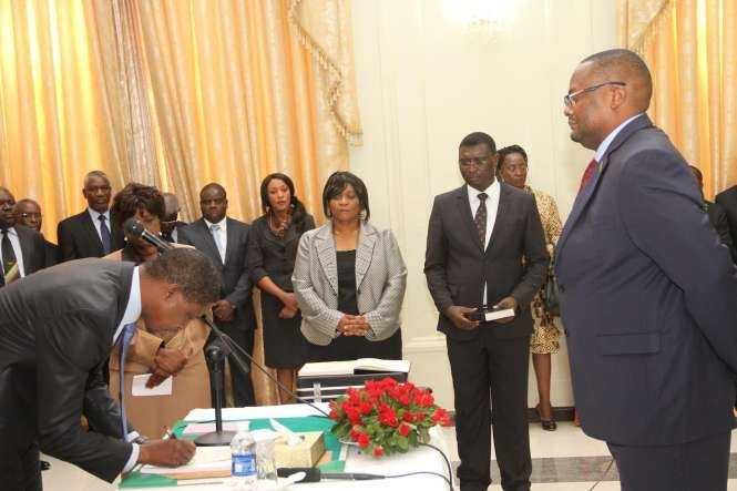 President Edgar Lungu signs on the affidavit of Oath document for Zambia's High Commissioner to South Africa Emmanuel Mwamba during the swearing -In-Ceremony at State House on May 4,2015 -Picture by THOMAS NSAMA:STATE HOUSE