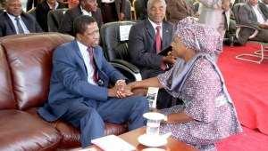 President Lungu greets Edith Nawakwi at an SDA event