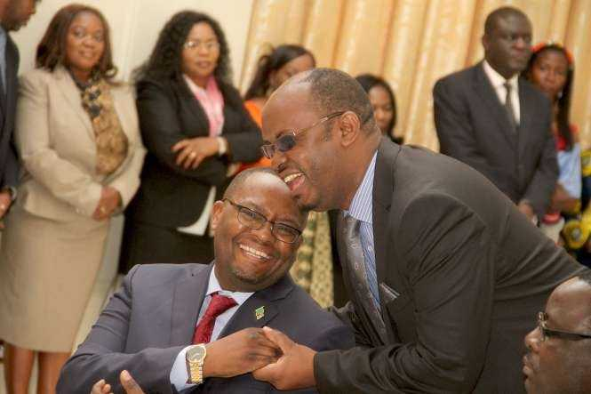 Zambia's High Commissioner to South Africa Emmanuel Mwamba being congratulated by PF deputy Chairman for Media Committee Sunday Chanda during the swearing -In-Ceremony at State House on May 4,2015 -Picture by THOMAS NSAMA