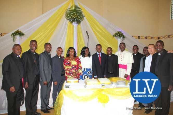 Lusaka Archdiocese Archbishop Telesphore George Mpundu ordains 11 priests at Lusaka Holy Cross Cathedral on Saturday, May 30th, 2015.   Archbishop joins his newly ordained priests in cutting a cake and thereafter joined them for  a family picture with Gender Minister Prof Luo Nkandu and Chiefs and Traditional Affairs Minister Joseph Katema.