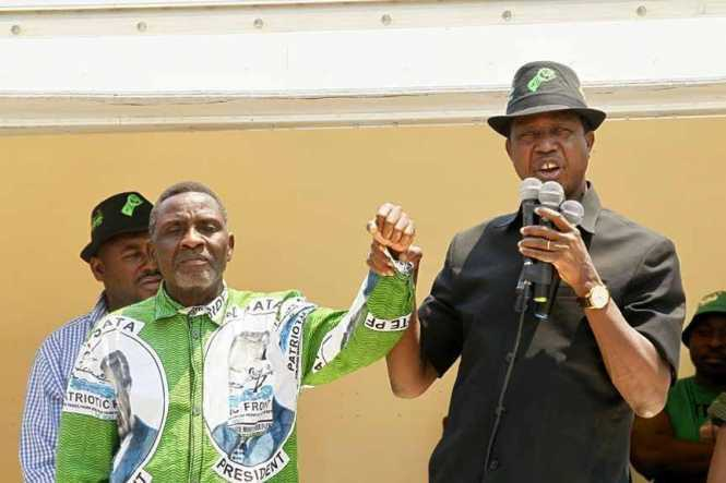 President Edgar Chagwa Lungu (right) introduces George Mwamba, the Patriotic Front(PF) Candidate for Lubansenshi Constituency