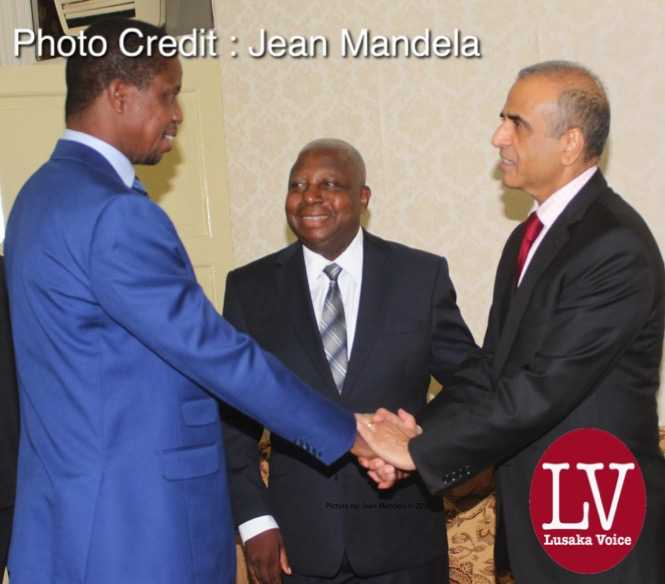 President Edgar Chagwa Lungu shaking hands with Bharti Airtel CEO and Chairman Sunil Bharti Mittal   while looking on is Airtel  Networks Zambia Plc Board Chairman  George Sokota