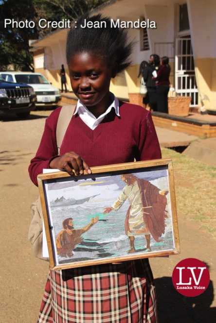 Kabulonga Girl pupil Mary Soteri doing her G12, her work was described as the best by her fellow pupils since it was made out of mosaic, it took her 9 months to complete it.