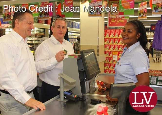 Superior Milling CEO Peter Cottan and Pick and Pay Director Group Enterprise Dallas Langman doing a transaction with the Pick and Pay cashier Rebecca Ngosa.