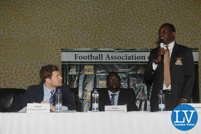 FAZ President Andrew Kamanga addressing the delegates while listening are FIFA Member Associations Manager Luca Nicola and FIFA Development Programmes Africa Manager Solaman Mudege